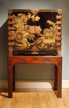 """A lacquer cabinet on stand. 1740 England. 60""""H x 37""""W x 20.5""""D."""