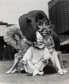 Elephant, clown and circus girls