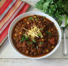 A thick, hearty and smokey chili filled with ground beef, black beans and corn and slow cooked all day.