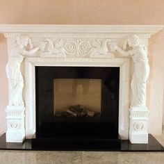 hand carved marble fireplace with a dru gas fire