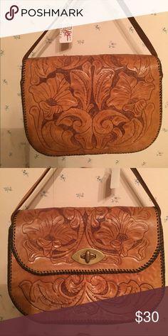 Vintage hand tooled leather bag Beautiful hand tooled leather bag. Excellent shape! Bags Mini Bags