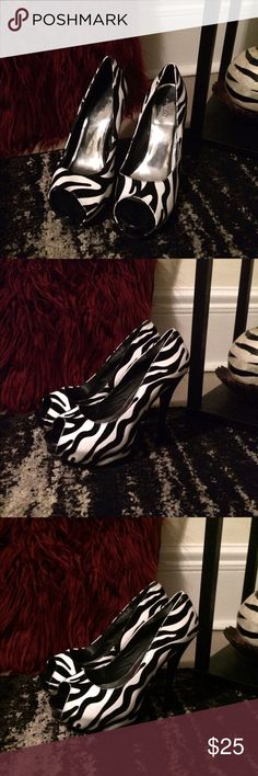Zebra print pumps Nearly New Zebra print pumps the white is leather the black is suede, a very sexy heel to go with your sexy black dress, animal print is always in style especially zebra I bought these from Deb's before they went out of business about two yrs ago but they have been in my closet since because I have been unable to wear heels shortly after purchasing hopefully someone else can get their sexy on with them they have lots of life in them! Shoes Heels
