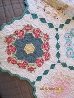 """Grandmothers flower garden quilt...love how she """"fussy cut"""" all the blocks."""