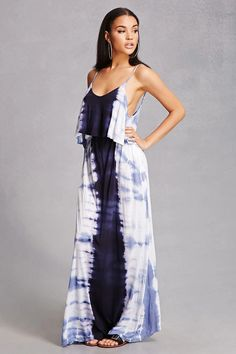 A knit maxi dress by Boho Me™ featuring a tie-dye wash at the sides, adjustable cami straps, a V-neckline, V-back with a strappy crisscross design, flounce layer, an elasticized waistband, and on-seam pockets.