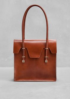 & Other Stories | Structured Leather Tote. A structured leather tote with a classic shape and gold finish embellishments.