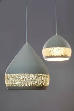 A Warm Glow Slips Through The Porous Skin Of These Ceramic Lampshades. Really cool pretty design for an accent lamp. Interior Lighting, Home Lighting, Lighting Design, Pendant Lighting, Pendant Lamps, Unique Lighting, Lighting Ideas, Jar Chandelier, Luxury Lighting