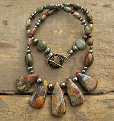 Earthy Tribal Necklace, Picasso jasper and pyrite drop necklace in red, gold, and green. $75.00, via Etsy.