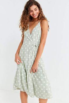 fd57cd0ecbf0 Shop Capulet Simona Polka Dot Midi Wrap Dress at Urban Outfitters today.