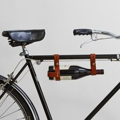 Going on a picnic or biking to a BBQ? Don't ride alone. Tuck a bottle of wine into this handcrafted leather bottle carrier and it's an instant bicycle built for two – just you and your favorite vino.