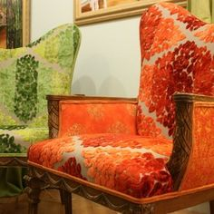Upholstered Chairs Carved Asymetrical Carved Arm Chairs Upholstered In Tricia Guild Tangerine And Kelly Green Fabrics custom made by Jane Hall The Voice Of Style