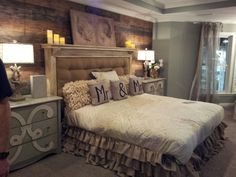 Master bedroom - I love the plank wall, layered ruffle skirt and pillows, and headboard.