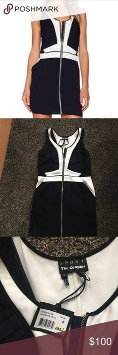 The Kooples Sport Dress NWT. Adorable sporty dress by the brand The Kooples -Sport- it is a dark navy blue color. Almost looks black in certain lighting. Really cool mesh detailing in the front and back. Zips all the way up the front of the dress. Has nice deep pockets on both sides that gives it the sporty look. The Kooples Dresses Mini