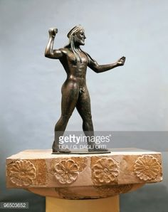 GREEK STATUARY : 6th-5th Century B.C., Italy, Taranto, Museo Archeologico Nazionale (Archaeological Museum), Egyptian appearance- engaged in various activities often with an implement or weapon of some sort in hand are common.