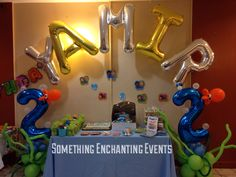 Name mega loon balloon arch. Huge number 2 with bubbles and an octopus at the cake table Balloon Arch, Balloons, Bubble Guppies Birthday, Cake Table, 2nd Birthday Parties, Birthday Candles, Party Themes, Bubbles, Number 2