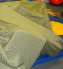 """make your own """"crash pad"""" """"moon walk"""" or """"foam bed""""  simply by filling a duvet cover with scraps of foam that you can get from almost any furniture or upholstering store for free."""