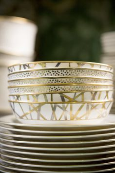 Kelly Wearstler: stack of gold patterned china