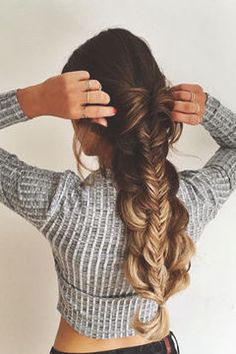 This looks like a herringbone braid on top of a regular braid.