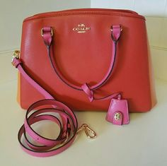 """COACH Colorblock Carmine MARGOT NWT!!! This darling carryall is simply perfection. Adorned with gold tone hardware and rolled leather handles, calling it beautiful is an understatement.  Goldtone hardware Lined interior with 3 multifunction pockets plus zipped center divider pocket and clasp top closure.   14""""(L) x 9""""(H) x 6""""(W) Rolled leather handles with a 3.75"""" drop  Adjustable and detachable shoulder/crossbody strap   No smoke / No pet home Coach Bags Shoulder Bags"""