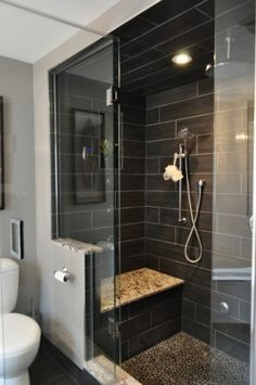 Frameless shower, granite bench, tile, pebble floor