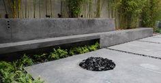 Outdoor concrete living area with concrete firepit | CHENG Concrete Exchange
