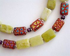 This necklace captures the shiny designs and flashes of color that will bring back those days at your favorite carnival.    The burnt orange-colored 12x8mm vintage German glass rectangle beads sport multi-colored metallic triangle patterns. Accented with polished silver-plated brass beads, they frame round purple Czech glass beads.    Strung with hand-cut creamy lime green Peridot Jasper, the necklace is spaced with tiny silver-lined Miyuki glass seed beads.    Carnival Necklace…