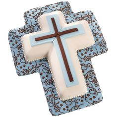 Celebrate baptisms, first communions or confirmations with this fondant-covered cross cake.