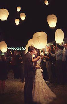 Wish lanterns make a stunning statement in an open sky. #wedding