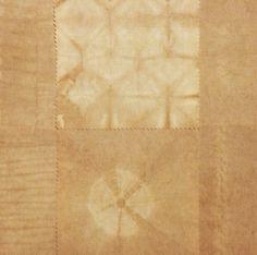 Walnut natural dye fabric sample using shibori techniques