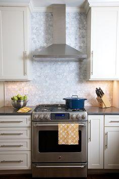 Carrara hex backsplash. Kitchen design by Marianne Strong Interiors