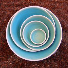 Ceramic Nesting Bowls in Turquoise Blue Large Set of Stoneware Pottery... ($130) ❤ liked on Polyvore featuring home, kitchen & dining, serveware, ceramic stoneware, stoneware serving bowl, ceramic serveware, pottery serving bowl and ceramic serving bowl