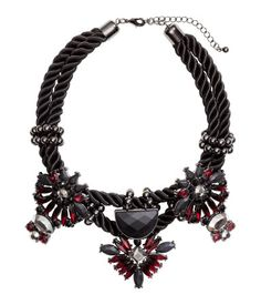 Short, twisted fabric necklace with metal pendants decorated with faceted plastic beads. Adjustable length, 15 3/4 - 19 in.