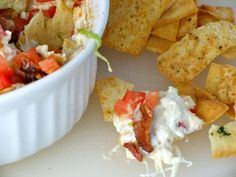 BLT Dip <><> 1 lb bacon, cooked, drained, crumbled, and divided <> 2 (8oz) packages cream cheese, softened <> 2C shredded mozzarella cheese <> 2C shredded Fontina cheese <> 1/2 C sour cream <> 1/2 C mayonnaise <> 1/2 tsp Italian seasoning <> 1 tsp garlic powder <> 2 T Dijon mustard <> salt & pepper to taste <> 1 1/2 C chopped seeded tomatoes <> 1 C shredded Iceberg lettuce <>  Toasted bread rounds, crackers, or pita chips (I'm crazy about Stacy's Pita Chips, Parmesan Garlic & Herb)