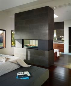 If your home is spacious enough to have room partitions built right inside, then you can create a two-sided fireplace with a lot of ease. Between the livin