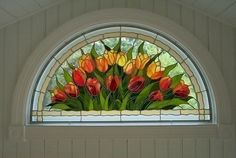 Tulip stain glass over door. Just gorgeous!