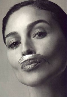 Monica Bellucci with anchovy :) Because, style means having a sense of humor.