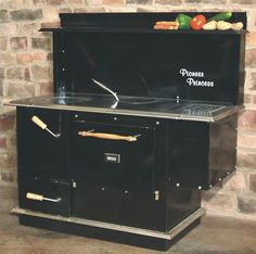 Pioneer Princess Wood Cookstove - comes with an optional hot water reservoir (lists $2895 to $2995 w options)