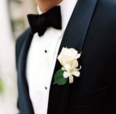 Very simple and classic white rose and orchid boutonniere.
