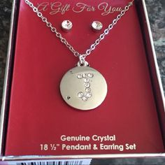 """""""J"""" crystal earring and pendant set """"J"""" Crystal  earring and pendant gift set. The two dots on the left side of j pendant are not imperfections. They are the reflection of my ceiling lights.  Jewelry Necklaces"""