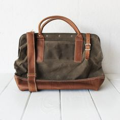 """I'm Loving the Northwester Bag from #CloakandDapper This would make a perfect size carry on bag for my laptop and all the other """"must haves"""" a blogger gal needs! ;) Are your tools-of-trade a hammer & nails or a laptop? Either way, we've got you covered.  Made to last a lifetime & Made in USA.   Approximate dimensions: 17in x 7in x 12in, Weight: 4.5 lbs."""
