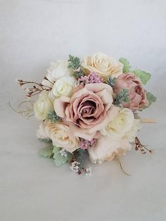 A stunning blush pink/peach silk bouquet. Perfect for a wedding! A lovely keep sake full of memories even after your special day. This lovely luxurious blush peach pink bridal bouquet is full with blush peach peonies, pink Peonies, blush peach Poppy, roses, pink Sedum, Gypsophilia,