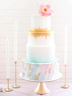 Watercolor gold cake with a map motif