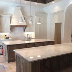 We finished building the second kitchen island- which can double as a large dining table with room to seat 8- painted the kitchen cabinets and installed the Macaubus Quartzite. Pure gorgeousness!!!