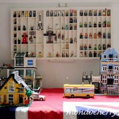 Joel likes this a lot. I have an old printer's box in the basement storage... need to go pull it out & hang on the wall.  He wants to display all his little lego guys!