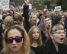 People attend the anti-government, pro-abortion demonstration in front of Polish Pariament in Warsaw, Poland, Saturday, Oct. (AP Photo/Czarek Sokolowski)
