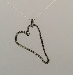 Sterling silver wire heart. Very delicate, embossed and textured silver