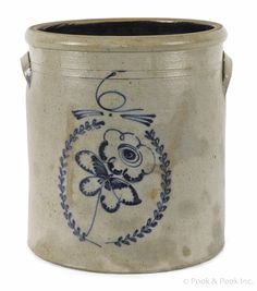 "Six-gallon stoneware crock, 19th c., with a cobalt flower in wreath decoration, 13"" h."