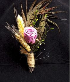 Lavender Rose with Pheasant Feather by justweddingbouquets on Etsy, $12.00..... different flower