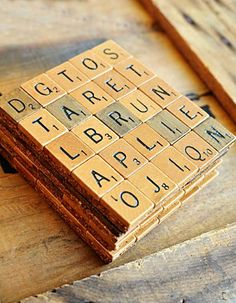 scrabble tile coasters (as placecards). the crossword game becomes a word search. not sure how i feel about that.