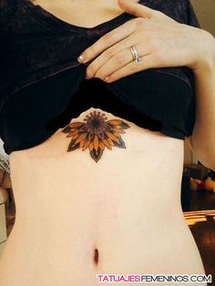 http://www.tatuajesfemeninos.com/wp-content/uploads/2014/10/tatuajes-de-girasoles-para-mujeres-18.jpg