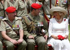 Camilla, Duchess of Cornwall smiles with members of the Royal Australian Corps of Military Police following a ceremony